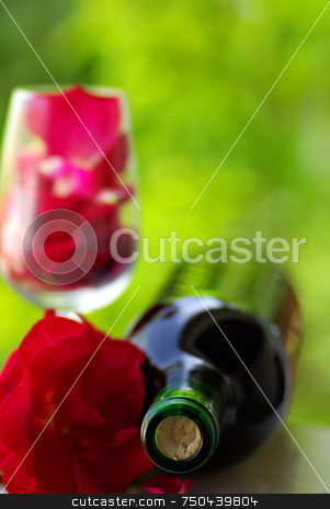 Petals of rose in a glass . stock photo, Petals of rose in a glass of red wine. by Inacio Pires