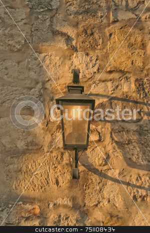 Light Fixture stock photo, An old antique light fixture on a stone wall by Kevin Tietz