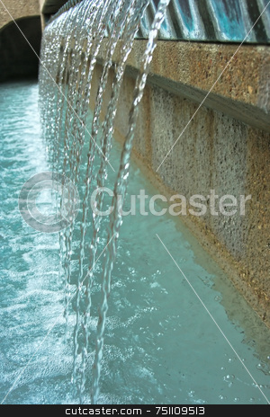 Modern Fountain stock photo, A crystal clear fountain pouring over the edge of a wall by Kevin Tietz