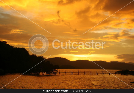 Yellow sunset stock photo, Yellow sunset with silhouettes of mountain, trees and  bridge by Jonas Marcos San Luis