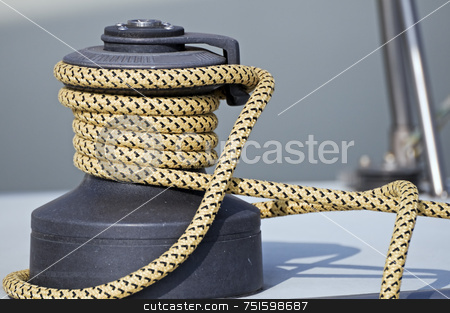 Winch stock photo, Rope rolled up on a winch in a sailboat by Massimiliano Leban