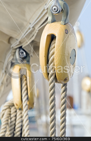 Old blocks stock photo, Old wooden pulleys on a sailing boat by Massimiliano Leban