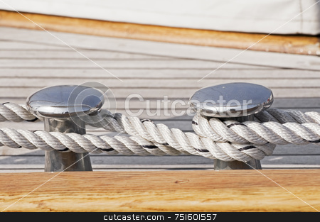 Moored boat stock photo, Close-up of rope securing a wooden boat to dock by Massimiliano Leban