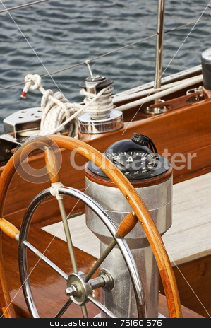 Rudder and compass stock photo, Rudder and compass on a wooden boat by Massimiliano Leban