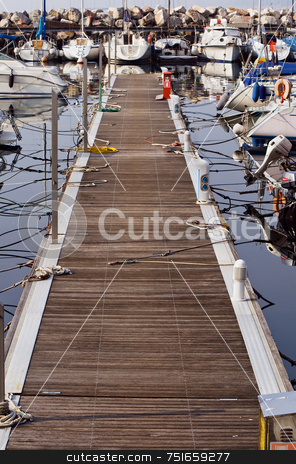 Pier stock photo, Rows of sailboats docked in harbor by Massimiliano Leban