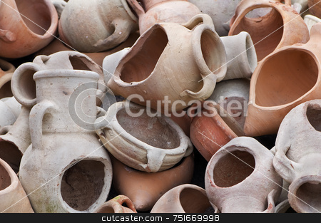 Broken amphoras stock photo, Stack of different kind of decorative terracotta containers by Massimiliano Leban