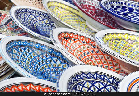 Painted dishes stock photo, Typical handmade coloured dishes displayed in an exhibition by Massimiliano Leban