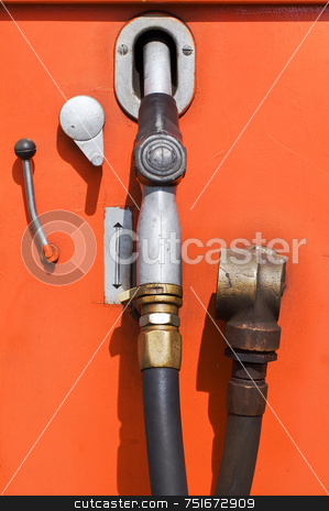 Old fuel pump stock photo, Obsolete orange fuel pump at a gas station by Massimiliano Leban
