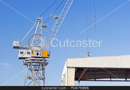 Crane stock photo, Detail of a crane under a blue sky in a shipyard by Massimiliano Leban