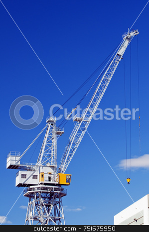 Crane stock photo, High crane under a blue sky in a shipyard by Massimiliano Leban
