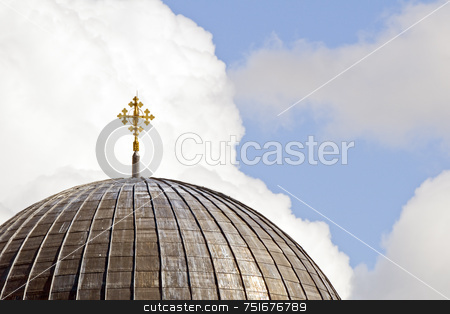 Dome stock photo, Close-up of a church dome with cross against a cloudy sky by Massimiliano Leban