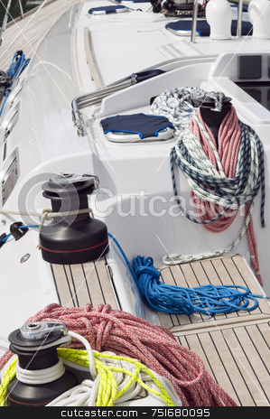 Sailboat stock photo, Detail of a boat with rigging and winches by Massimiliano Leban