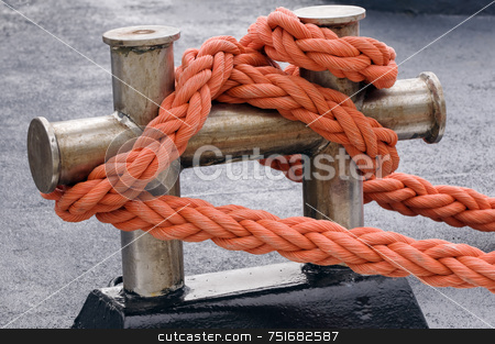 Moored boat stock photo, Close-up of an orange rope tied to a bitt by Massimiliano Leban