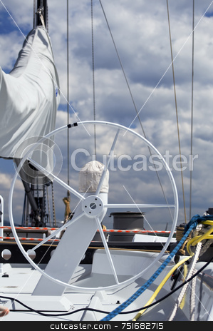 Rudder stock photo, Detail of rudder and equipment on a sailboat against a cloudy sky by Massimiliano Leban