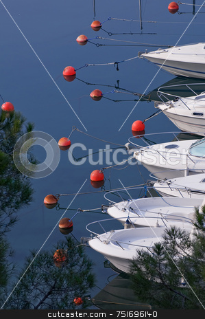 Marina stock photo, View on a marina with moored motorboats bows by Massimiliano Leban