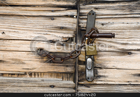 Closed gate stock photo, Old wooden gate locked with chain and padlock to handle by Massimiliano Leban