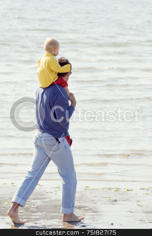 Father and son stock photo, Father with son on his shoulders walking barefoot on the shore-line by Massimiliano Leban