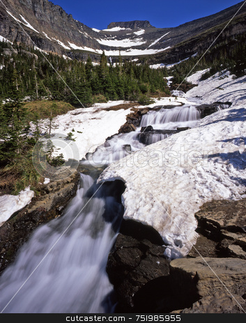 Glacier Waterfall stock photo, A small waterfall in Glacier National Park, Montana. by Mike Norton