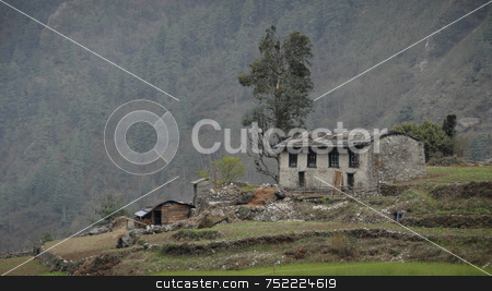Hillside Village home in Nepal stock photo, Ghat Village Home in Himalayas by A Cotton Photo