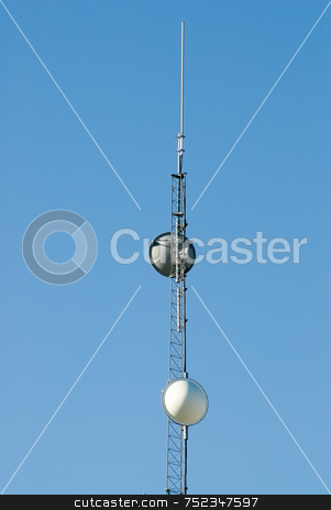 Communications Tower stock photo, A tall tower with satellites in order to receive signals, shot against a blue sky by Richard Nelson
