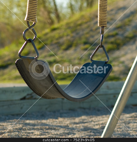 Empty Swing stock photo, A single swing, sitting empty on a playground by Richard Nelson