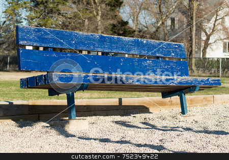 Blue Park Bench stock photo, A low angle view of a blue park bench by Richard Nelson