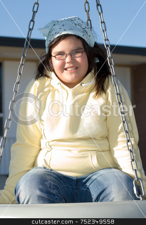 Girl On Tire Swing stock photo, A young girl with glasses, swinging on a tire swing by Richard Nelson