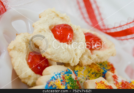 Christmas Cookies stock photo, Home baked Christmas cookies with candied cherries and sugar sprinkles on white plate. Closeup with red ribbon in bacground. by ngirl