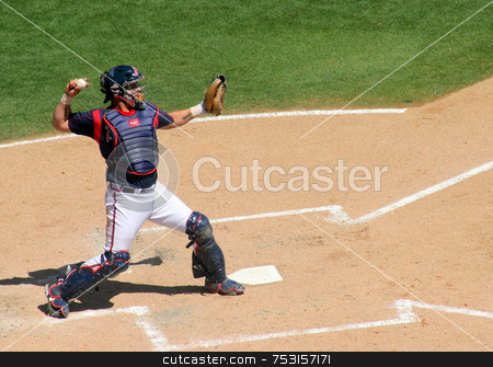 Catcher throwing to second base stock photo, The catcher throwing the ball at a baseball game by Lucy Clark