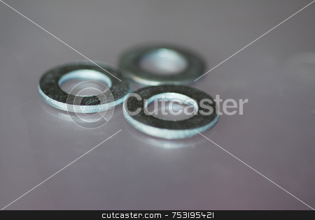 Tools of the Trade stock photo, An extreme close-up photograph of three washers for household repairs by Philippa Willitts