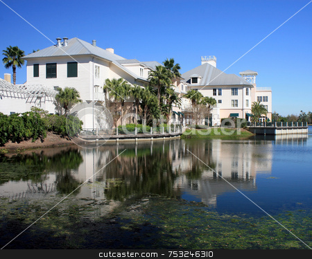 Florida Hotel stock photo, Florida Hotel with reflections in the lake. by Lucy Clark