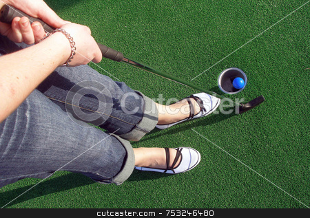Adventure Golf stock photo, Putting a ball at an adventure golf. by Lucy Clark