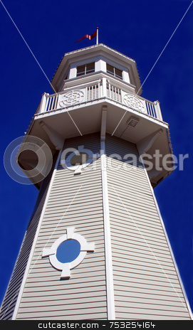 Lighthouse stock photo, A lighthouse with pure blue sky upward view. by Lucy Clark