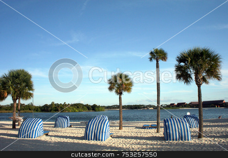 Beach View stock photo, A beach and a lake with palm trees. by Lucy Clark