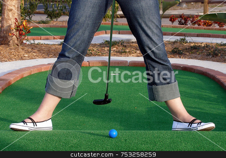 Adventure Golf stock photo, Playing Adventure Golf, downhill shot, ball, club and hole. by Lucy Clark