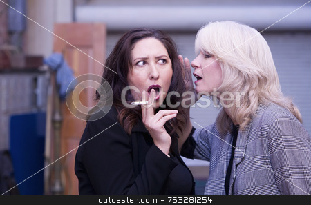 Women Gossip During a Smoking Break stock photo, Two women engaging in gossip during a smoking break by Scott Griessel