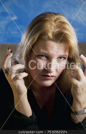 Frustrated Blonde Woman stock photo, Close up of frustrated blonde woman in a studio. by Scott Griessel