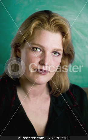 Blonde Woman stock photo, Close up of blonde woman in a studio setting. by Scott Griessel