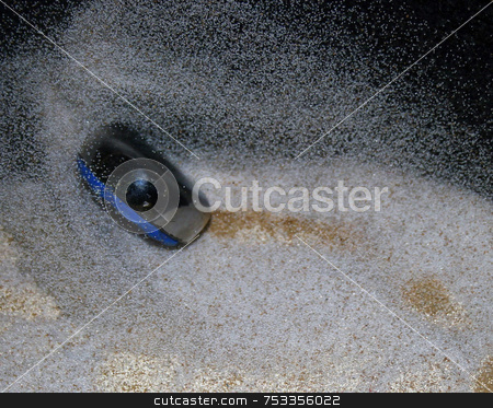 Shuffleboard Puck stock photo, This is a shuffleboard fly going through the sand. by Lucy Clark
