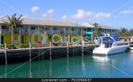 Bahamas stock photo, Colorful waterfront houses in the Bahamas and a boat. by Lucy Clark