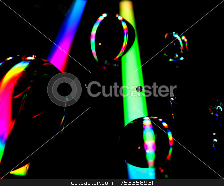 Beams Of Colour And Light stock photo, This is a cd with water droplets on it. 2 beams made from a lamp and my flash. by Lucy Clark