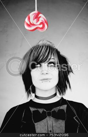 Alternative Girl Looking at a Heart Lollipop stock photo, Alternative Girl Looking up at a Heart Lollipop by Scott Griessel