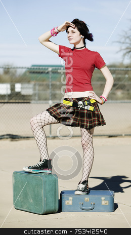 Model Standing on Suitcases stock photo, Young alternative woman standing on top of two blue suitcases by Scott Griessel