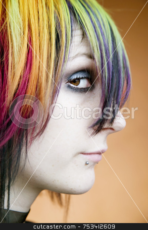 Alternative girl with multi-colred hair looks up stock photo, Close-up of an alternative girl with multi-colred hair looking up by Scott Griessel