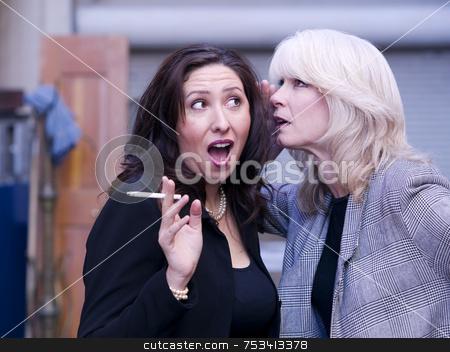 Women Gossip During a Smoking Break stock photo, Two women engaging in gossip during a smoking break by Scott Griessel