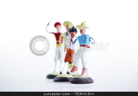 Mexican Clay Toy Figurines stock photo, Whimsical mexican clay toy cowboys on a white background. by Scott Griessel