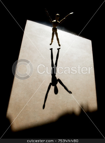 Artist's Model with a Long Shadow stock photo, Artist's model with heavy backlight and arms outstretched throws a long shadow. by Scott Griessel