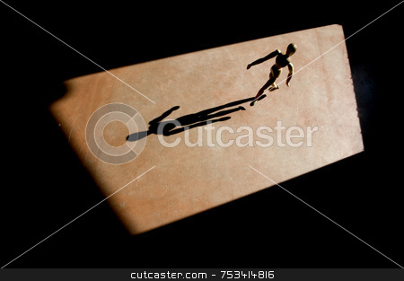 Artist's Model Walking with a Long Shadow stock photo, Artist's model with heavy backlight walks and throws a long shadow. by Scott Griessel