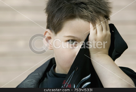Boy hiding his face stock photo, Little boy hides his face behind the tail of his own shirt. by Scott Griessel
