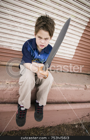 Angry Boy with a Toy Sword stock photo, Angry Young Boy Pointing a Plastic Sword by Scott Griessel